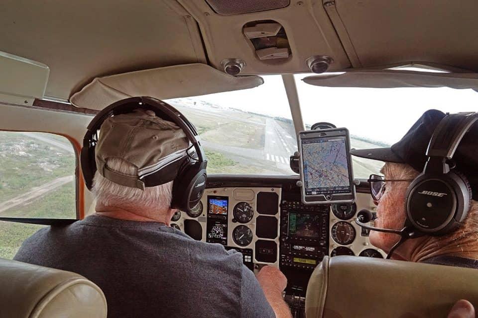 Veteran Yellowknife pilot Dave Crerar and his friend, fellow pilot John DeBourcier on final approach into Yellowknife Airport, returning from Plummer's Lodge.