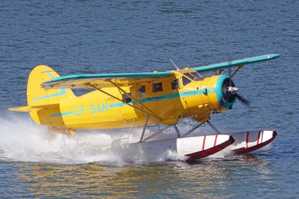 """Buffalo Joe"" McBryan takes off on Back Bay in his vintage Norseman on his way to fly past Pilot's Monument"