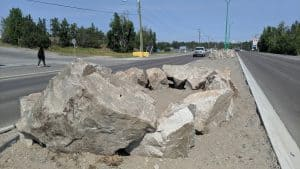 Rocks appearing in the median on a stretch of Yellowknife road in July 2019