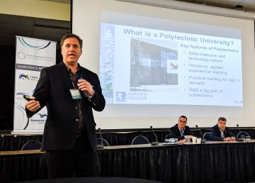 Tom Weegar, president of Aurora College, speaks at a conference in Inuvik in June 2019