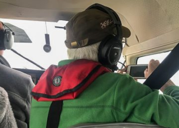 Casara members Jeff Anderson and Dave Taylor in the air above the North Slave