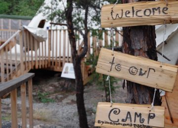 A handmade sign welcomes people to Yellowknife's Arctic Indigenous Wellness Foundation's healing camp