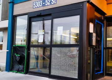 Damage to the entryway doors at the Fraser Tower