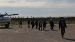 Dignitaries step off plane at Whati ground breaking ceremony August 2019