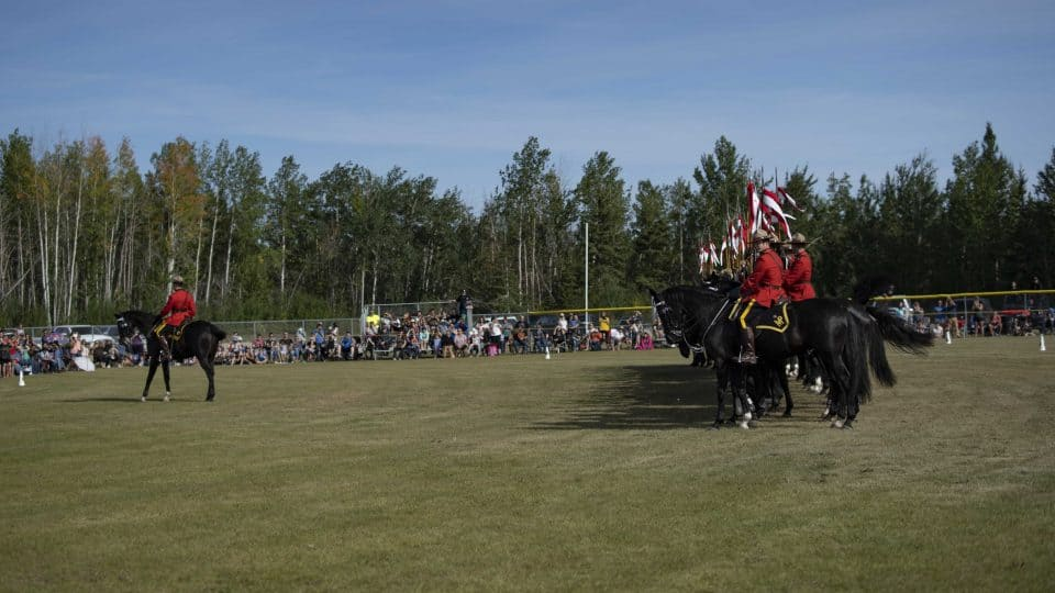 The RCMP Musical Ride stands for O Canada. Sarah Pruys/Cabin Radio