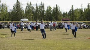 Hay River's Filipino Marching Band shows off their moves and music before the RCMP Musical Ride starts. Sarah Pruys/Cabin Radio