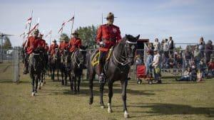 The RCMP Musical Ride enters the Keith Broadhead Memorial Twin Park. Sarah Pruys/Cabin Radio