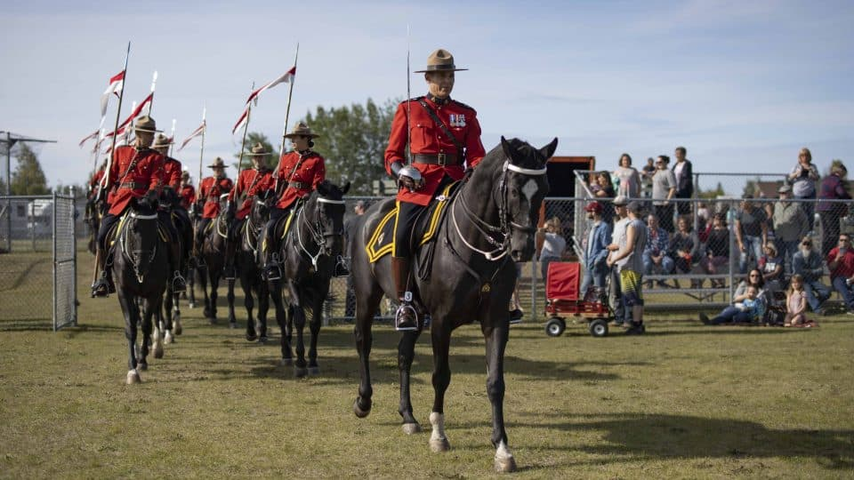 The RCMP Musical Ride enters the Keith Broadhead Memorial Twin Park. Sarah Pruys/Cabin Radio