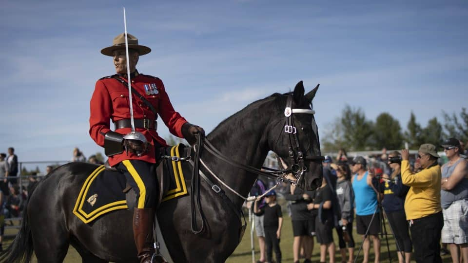 An RCMP rider looks back at the Musical Ride. Sarah Pruys/Cabin Radio