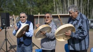 The Kátł'odeeche First Nation Drummers, lead by Joe Tambour, centre, open at the RCMP Musical Ride. Sarah Pruys/Cabin Radio