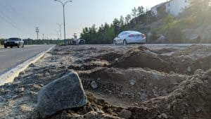 One lone rock remains on the Franklin Avenue median. It will soon be joined by other small rocks. Sarah Pruys/Cabin Radio