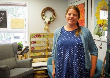 Sarah Kalnay-Watson, a Win Your Space winner in 2017, inside her Let Me Knot flower shop in August 2019