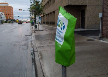 A green bag covers parking meters in downtown Yellowknife on September 3, 2019