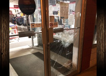 An RCMP handout image of damage to a door at Hay River's Fields store.