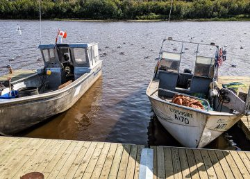 Fishing boats on the Hay River in August 2019