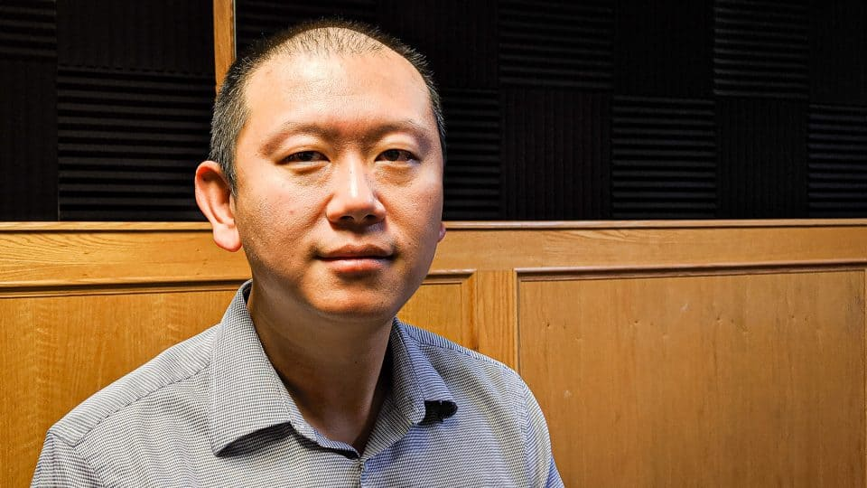 Liang Chen at the Cabin Radio studios in August 2019
