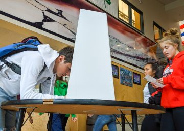 A Yellowknife high school student marks a ballot behind a screen during a mock federal election on October 18, 2019