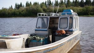 A fishing boat docked in Hay River in August 2019. Sarah Pruys/Cabin Radio