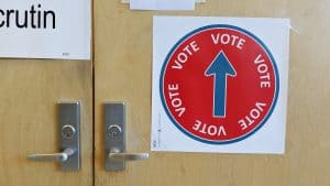 A sign directs voters to their polling station. Sarah Pruys/Cabin Radio