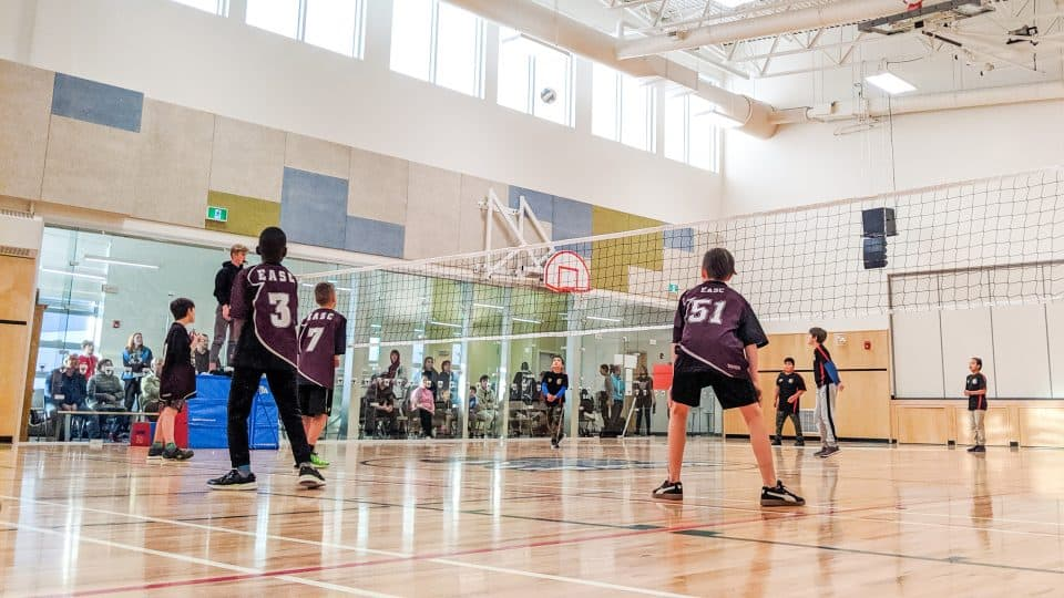 A volleyball game inside the Allain St-Cyr gym