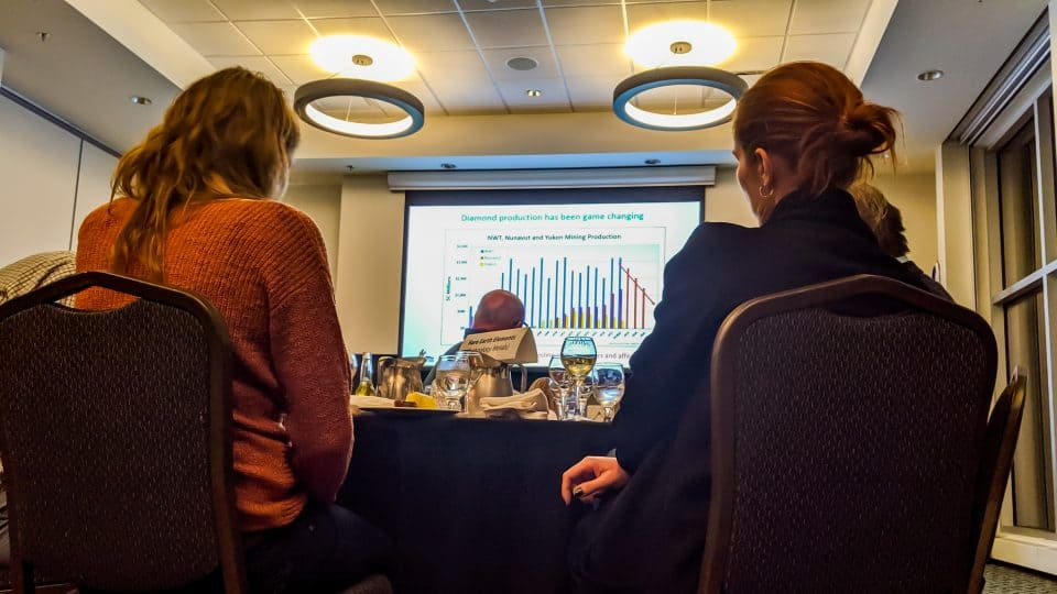 MLAs Katrina Nokleby, left, and Caroline Wawzonek attend a chamber of mines briefing on the NWT's economy