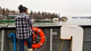 Zhanayii Drygeese, 17, looks out at Great Slave Lake from the bow of research vessel Nahidik