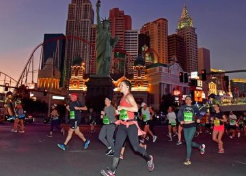 Runners pass by a miniature New York on the Las Vegas strip