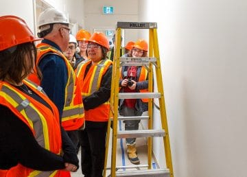 Paulie Chinna, the housing minister (centre), talks to NWT Housing Corporation boss Tom Williams as they tour the Yellowknife's women's emergency shelter