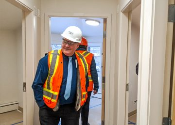 Tom Williams inspects rooms at the renovated Yellowknife emergency women's shelter