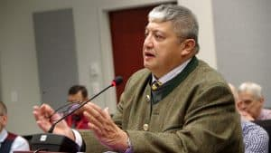 General manager of the Days Inn and Suites and president of the Yellowknife Hotel Association Joey Cruz presents at a public hearing January 13 on zoning changes with short term rentals. Emelie Peacock/Cabin Radio