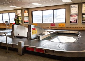 A traveller waits inside Inuvik's Mike Zubko Airport in April 2018