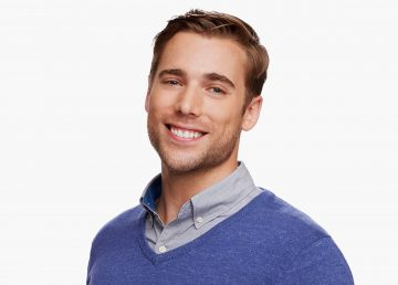 Dustin Milligan as vet Ted Mullens in a Schitt's Creek promotional image