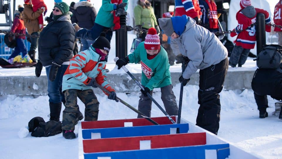 Children play a game involving getting their hockey puck through a maze at Hockey Day in Canada. Sarah Pruys/Cabin Radio
