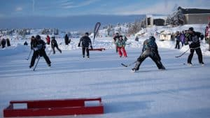 A pond hockey tournament takes place on Frame Lake in Yellowknife during Hockey Day in Canada. Sarah Pruys/Cabin Radio