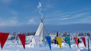 A tipi is set up at Hockey Day in Canada so people can warm up. Sarah Pruys/Cabin Radio