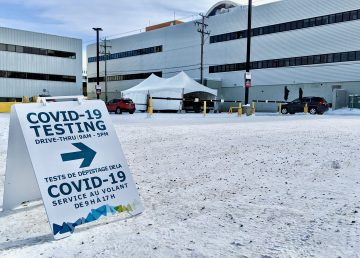 A sign points to Yellowknife's downtown drive-through Covid-19 testing clinic