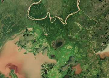 A satellite image shows Lake Claire, a portion of Lake Athabasca, and a portion of the Peace River