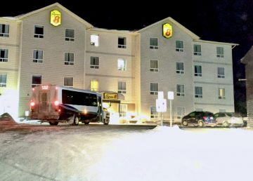 A tour bus arrives at a Yellowknife hotel on Monday, March 16, 2020