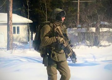 An RCMP officer in tactical apparel responds to an incident in Fort Smith