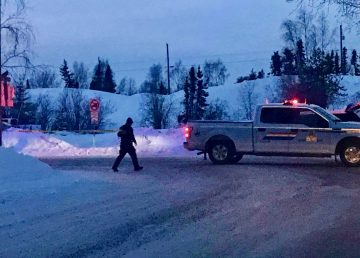 A police officer outside Yellowknife's Sunridge Place on March 24, 2020