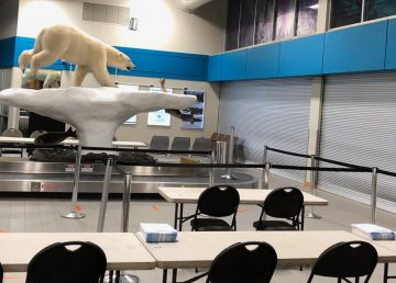 Yellowknife Airport sits empty with desks and chairs awaiting travellers who will be told to self-isolate