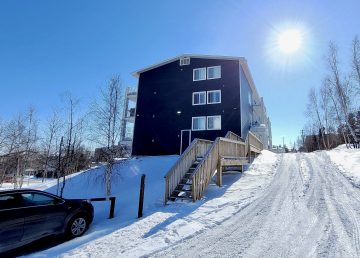An apartment building in downtown Yellowknife is pictured in April 2020