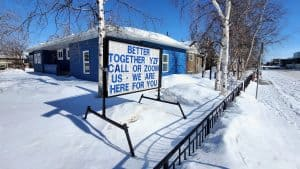 """A sign outside LCP Health in Yellowknife urges residents to be """"better together"""" during the Covid-19 pandemic"""