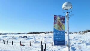 """A """"discover downtown"""" banner next to Yellowknife's Frame Lake in April 2020"""