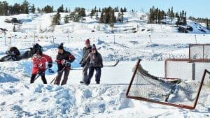 Yellowknife residents play hockey on Frame Lake in April 2020