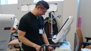 A member of the NWT's biomedical engineering team assembles a ventilator in a photo published by the territory's health authority