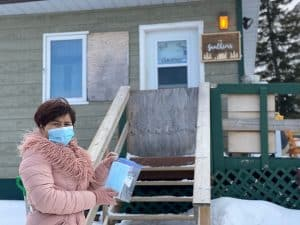 Ha Duong leaves masks on the doorsteps of Hay River residents