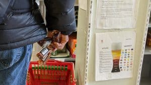 A customer waits in line to pay at a liquor store in Yellowknife