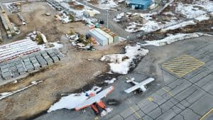 Light aircraft and industrial containers at Yellowknife Airport in May 2020