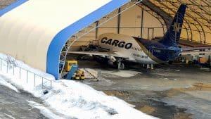 A cargo aircraft inside a hangar at Yellowknife Airport